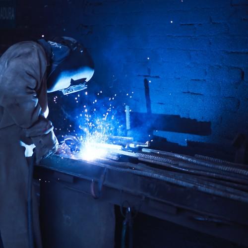 image wearing welder helmet and welding