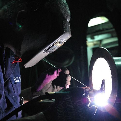 image of a welder wearing ppe